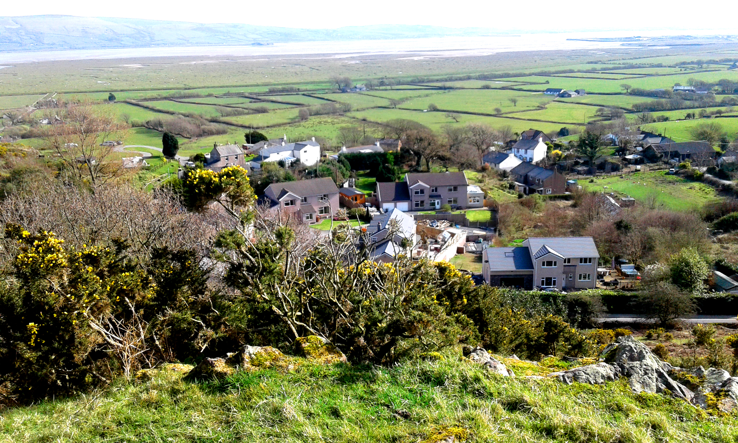 Looking down on the village of The Hill with th eDuddon Estuary in the distance