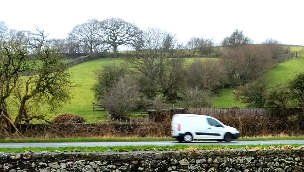 White van being driven along the road