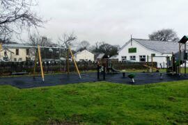 View across play area towards the village hall